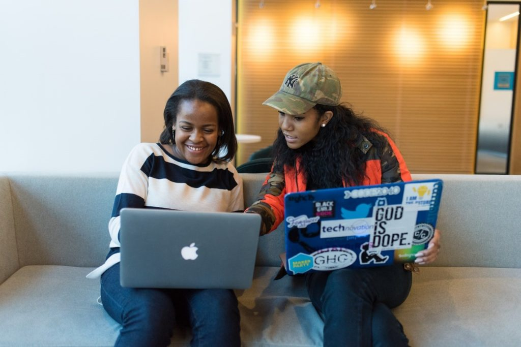Girls working on Laptops
